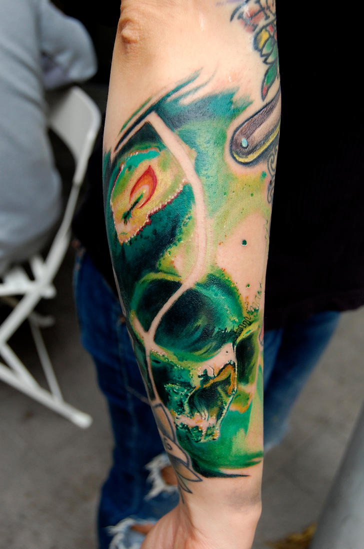 green skull by tattooneos