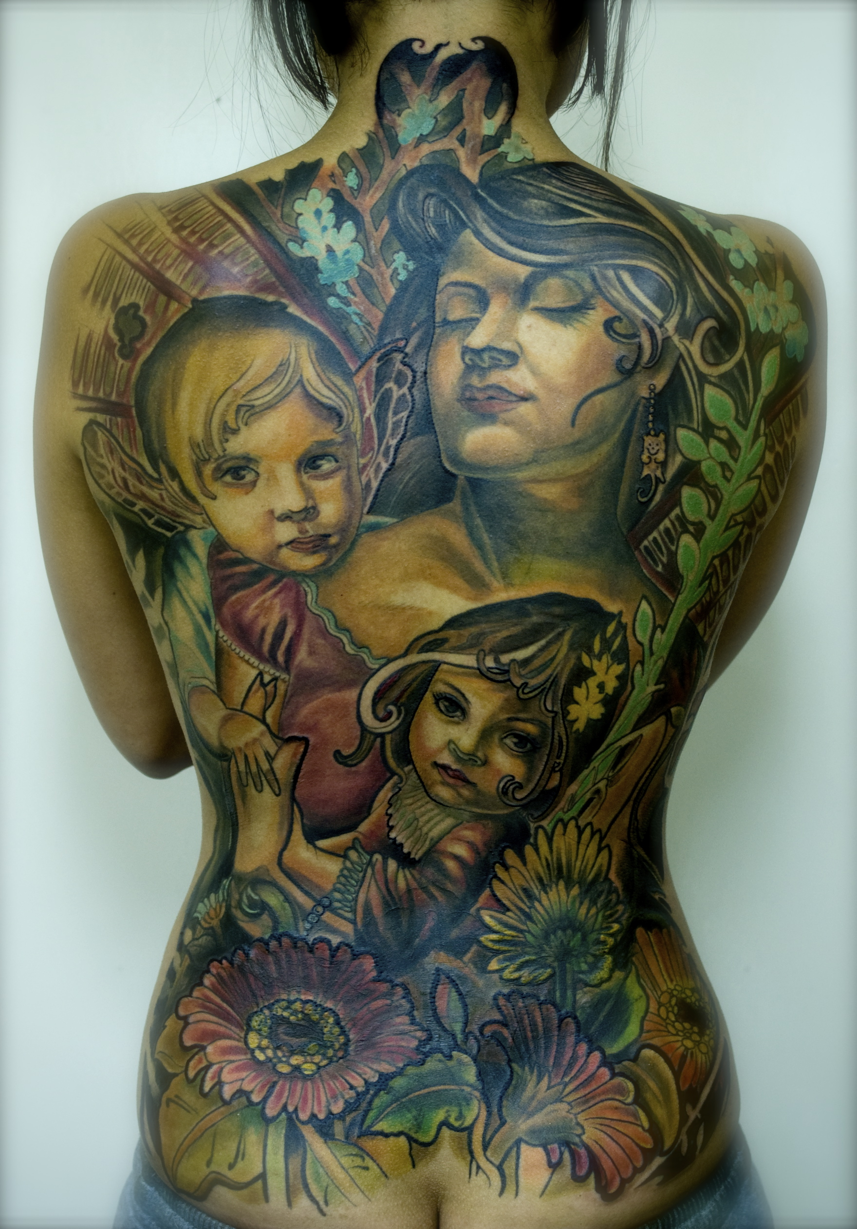 Unconditional Love backpiece by tattooneos
