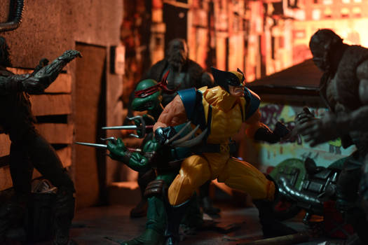 Wolverine and Raph fighting zombies