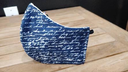 Writing on Navy mask