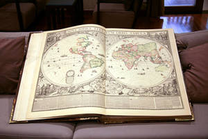 Huge map book, open book