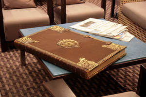 Old leather book on table 2 by barefootliam-stock