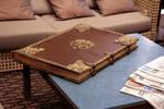 Old leather book locked bg