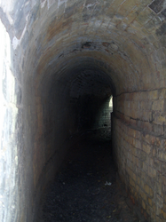 curved brick/stone tunnel by barefootliam-stock