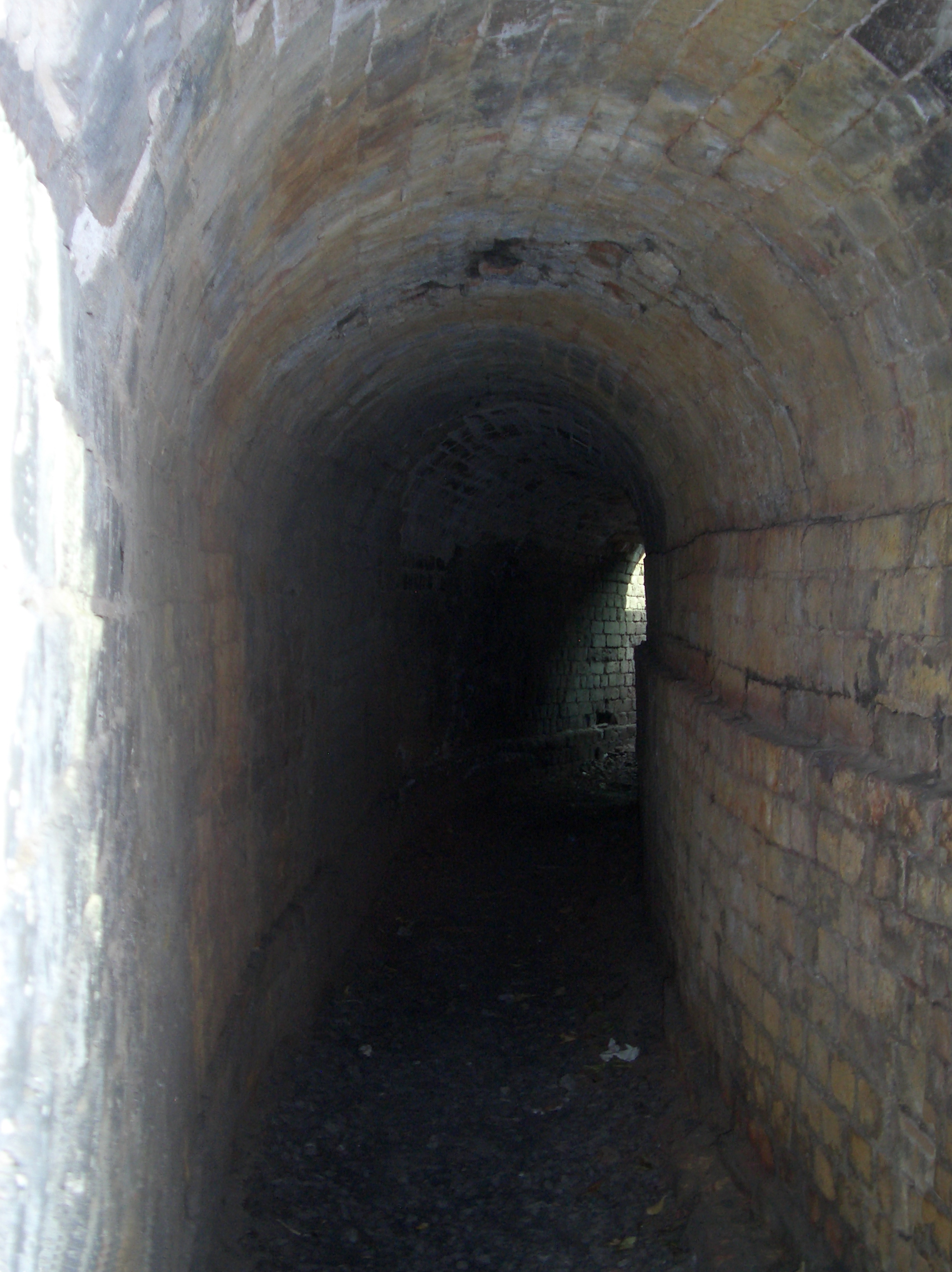curved brick/stone tunnel