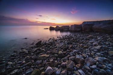 Sunset at the seashore by Koljan
