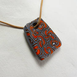 Orange Swirl Pendant by Mdnghtkith