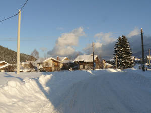 Snowy Road Leading Through The Village