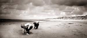 Boy and Dog on the Beach