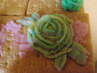 multi colored buttercream frosting rose by yellowribonsky