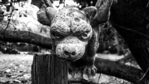 Scowling front yard gargoyle  by sethses1