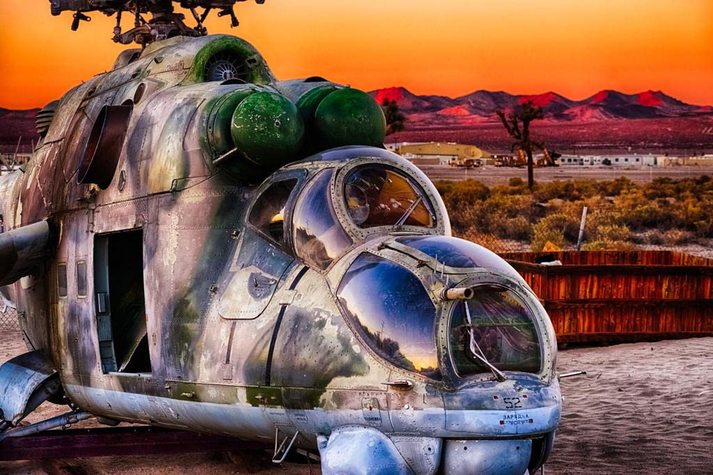 http://img00.deviantart.net/8171/i/2015/026/a/4/derelict_airfield_at_sunset_by_rickbattle-d8fk6tf.jpg