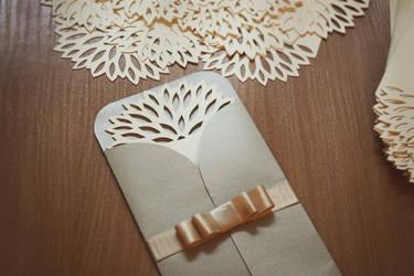 Beautiful papercutted wedding invitation by InnaAdamenya