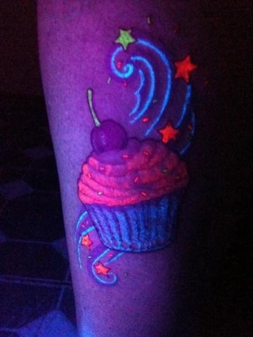 UV ink cupcake tattoo by Inkedromeo18