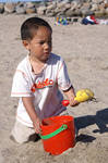 Boy playing in the sand 1