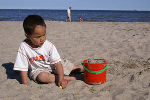 Boy playing in the sand 2 by slaust
