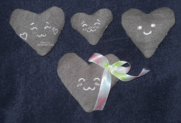 4 grey hearts with faces - experimental by Dassi121
