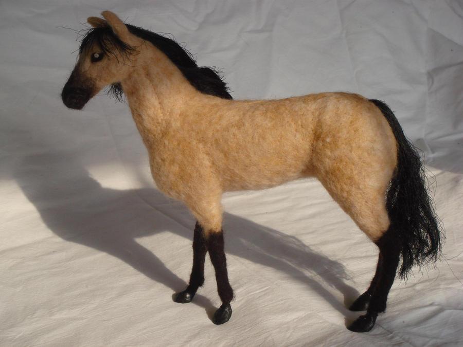 Needle felted buckskin horse, side view.
