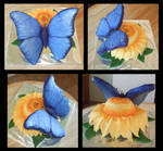 Blue butterfly and flower cake
