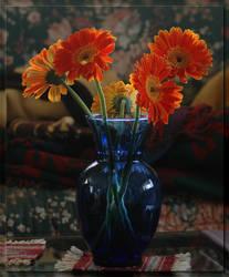 Daisies in Blue Vase