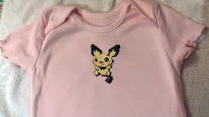 Pichu cross-stitched pink baby onesie