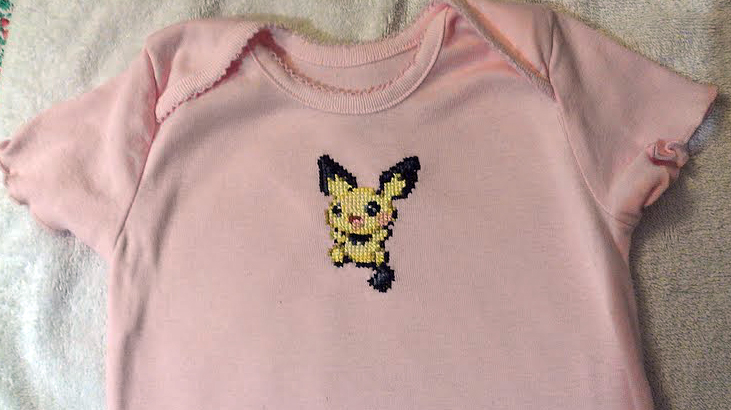 Pichu cross-stitched pink baby onesie by starrley