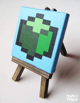 a mini green isometric voxel