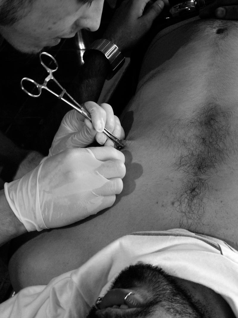 Verticle Nipple Piercing by