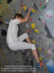 Rock Climbing Man Looking Down from Wall Pose Ref by SenshiStock