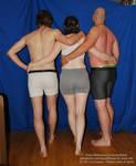 Three People Back Pose Together Hugging Holding