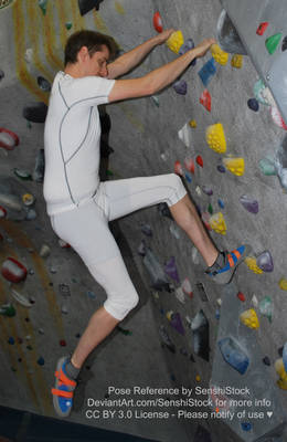 Rock Climbing Male Model Scaling Bouldering Wall