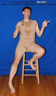 Guy with a Drink Sitting on a Stool Finger Gun