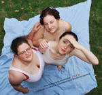 Three Models Together Looking Up Top Down by AdorkaStock