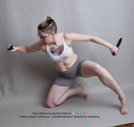 Dual Blade Kneeling Lunge Pose Reference by AdorkaStock