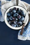 Fresh plums (prunes) in bowl