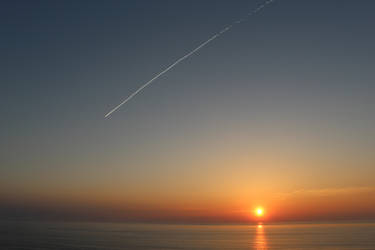 Sunrise and Jet Stream by MillyT