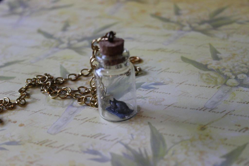 Little black Puppy necklace by Dellessanna