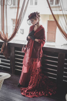 Dark-red victorian dress with a bustle