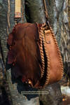 brown hand carved oak leaf purse with toggle faste