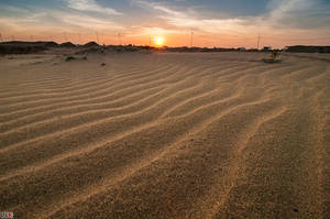 Sunset and the ripples sands