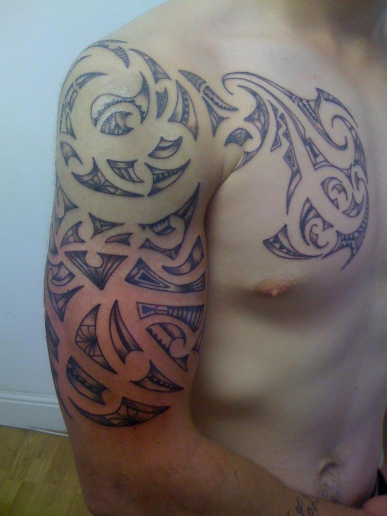 maori arm chest - chest tattoo