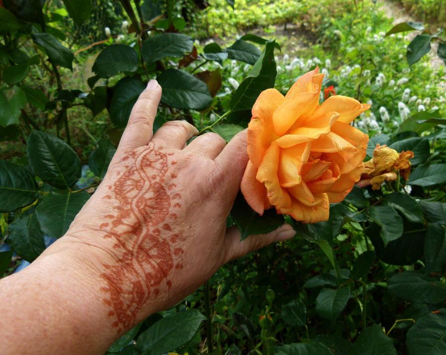 Henna tattoo hand design by