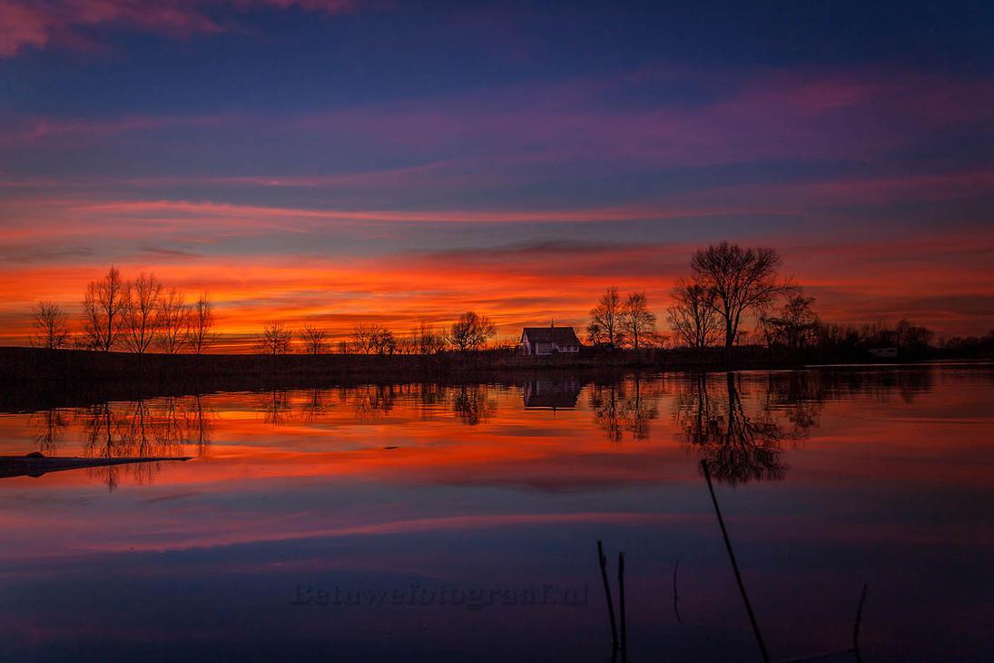 Sky on  fire............ by Betuwefotograaf