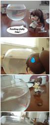 Feeding the Fishy by KittyAzura