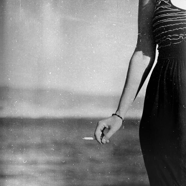 A girl and a cigarette by invisigoth88