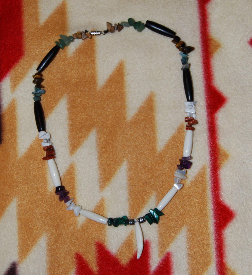 wolf tooth necklace by jezabelpheonix on deviantart
