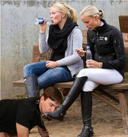 Rich girls getting their boots polished by yoohooguy