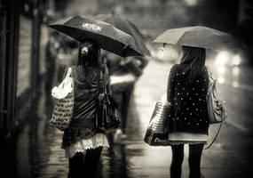 umbrellas in the rain by fbuk