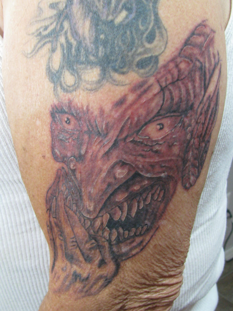 Evil face tattoo by dannewsome on deviantart for Evil faces tattoos