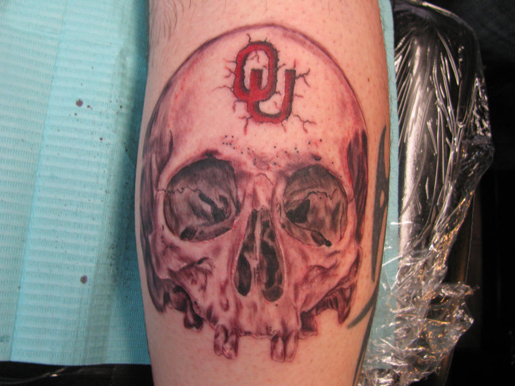 Skull in cherry wash ou fan tattoo by dannewsome for Tattoo shops okc